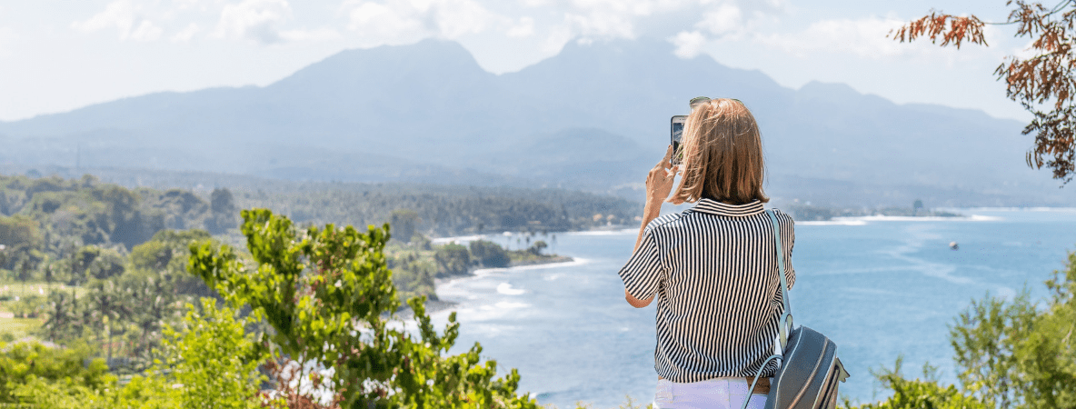 Woman taking a picture on holiday