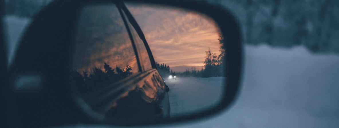 Car mirror in the snow