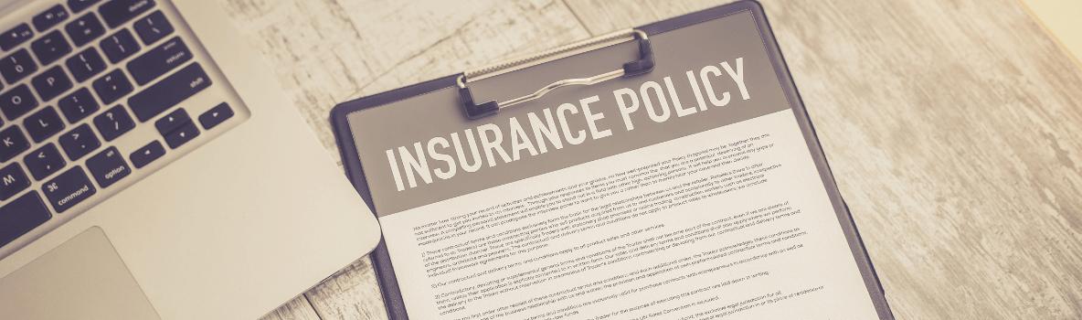 insurance policy alongside a laptop