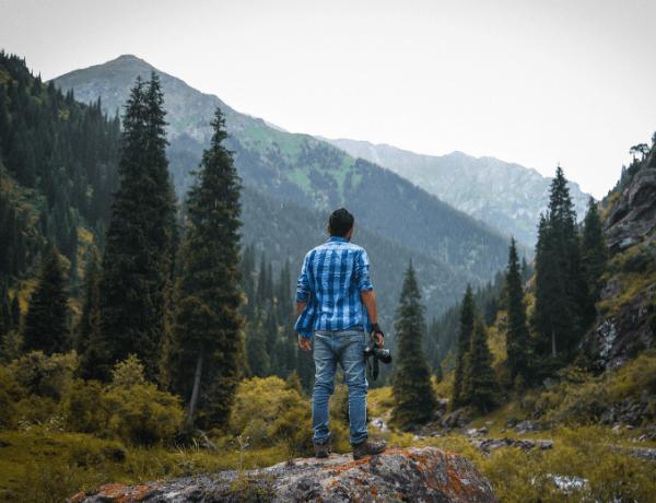 Man taking photographs on travels