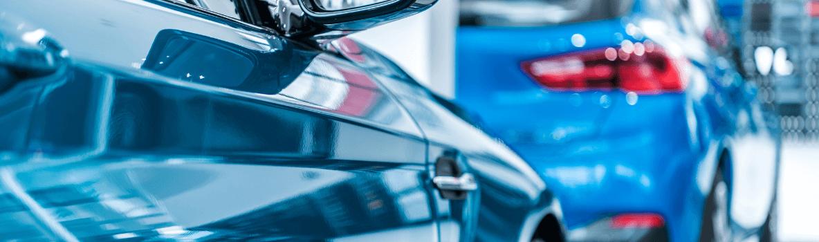 blue cars in showroom