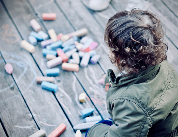 Child playing with chalk