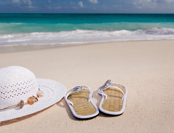 How can you avoid adding extra costs to your holiday?