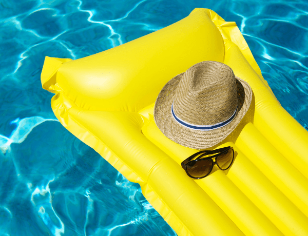 swimming pool with sunglasses and hat