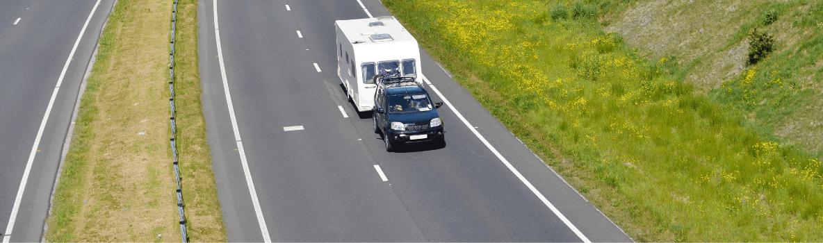 cars towing caravans on a dual carriageway