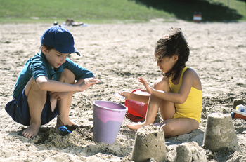 Forget new-fangled holiday activities – building sandcastles still has pride of place in kids' hearts
